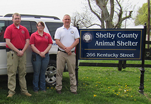 Animal Shelter sign and employees